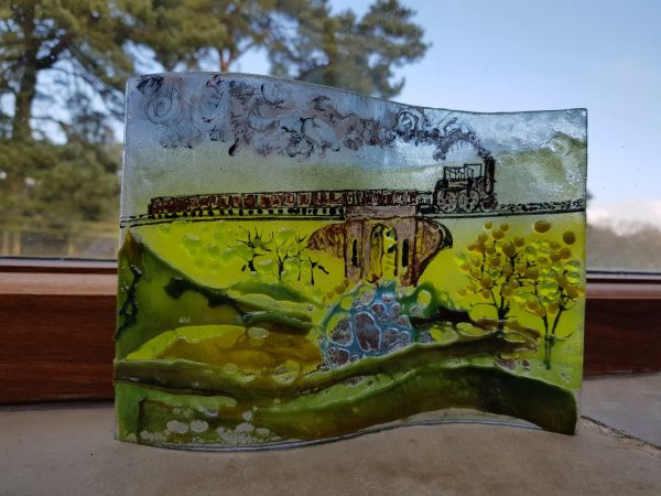 Glass wave hand painted with an image of Locomotion. No.1 travelling over it